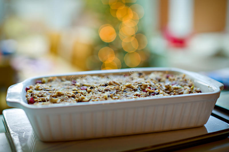 Nut Roast. Vegetarian meal of nut roast in a baking dish with narrow depth of field and bokeh from Christmas tree lights in the background stock photo