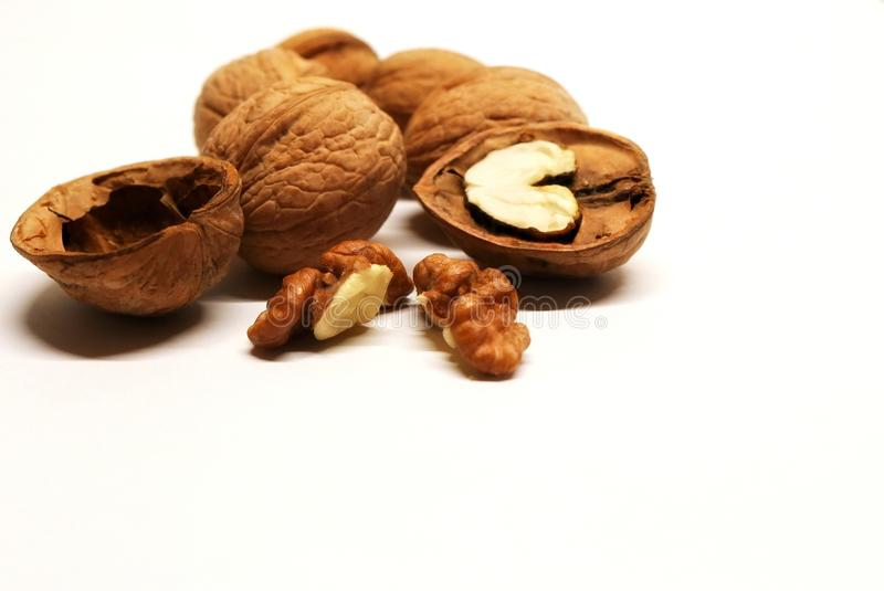 Nut. Walnuts. Chopped nuts. Nuts and shells of walnuts. A useful product. A caloric product. stock image