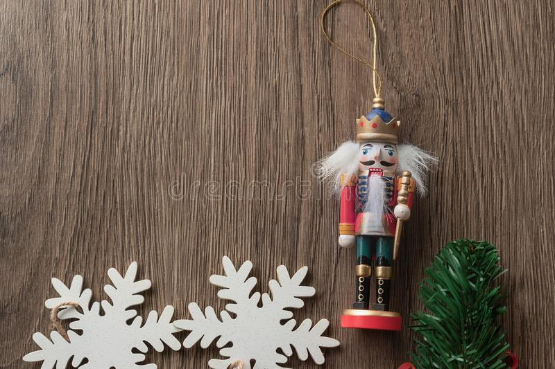 Nutcracker soldier and white snowflakes on a textural background, christmas card. Isolated nutcracker soldier and white snowflakes on textural background stock photo