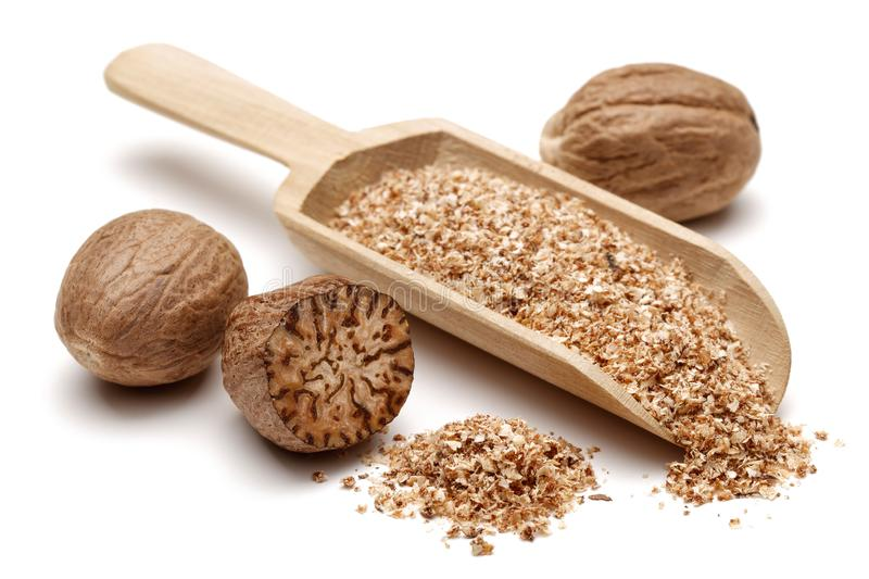 Nutmeg and granules in wooden scoop royalty free stock images