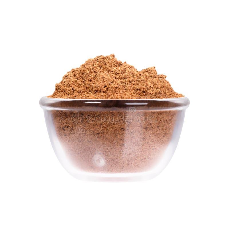 Nutmeg powder in glassy saucepan on white background. High resolution photo royalty free stock photos