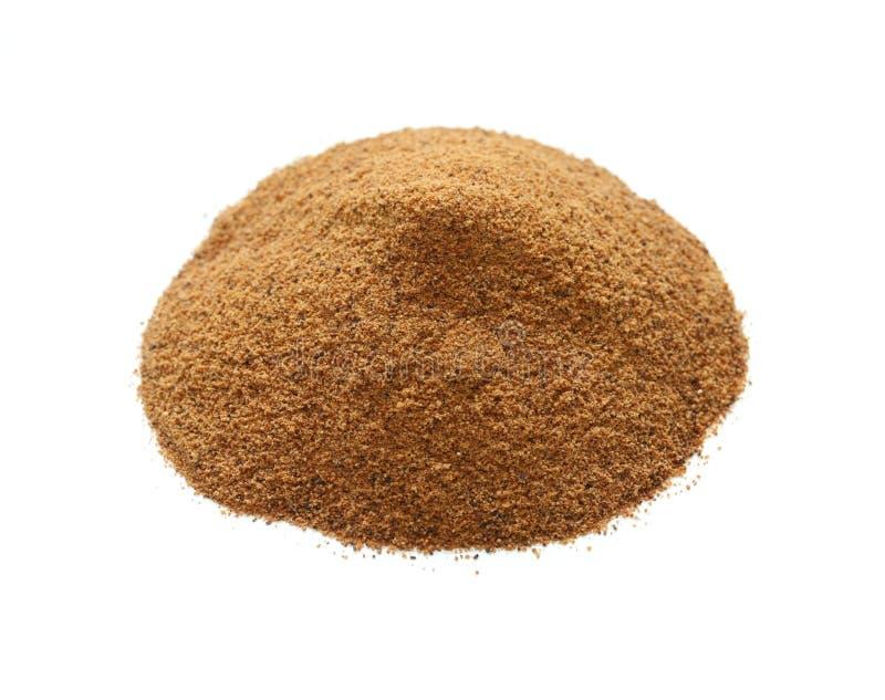 Nutmeg powder , indian spice. On white background royalty free stock image