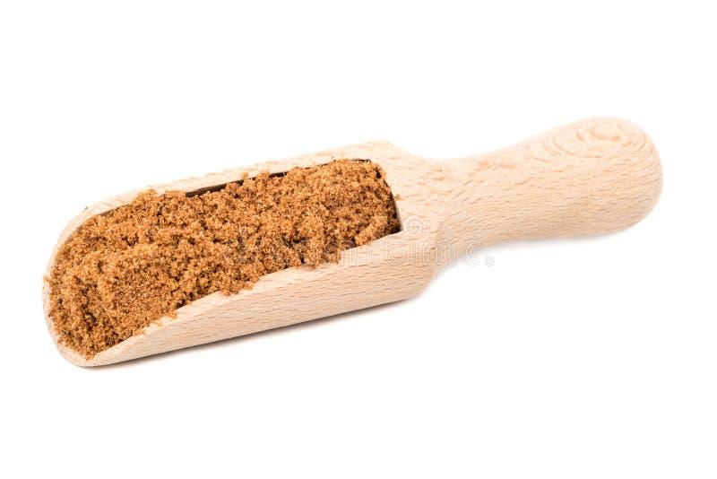 Nutmeg powder in scoop. Nutmeg powder in a scoop isolated on white background stock photography