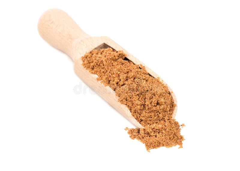 Nutmeg powder in scoop. On white background royalty free stock photos