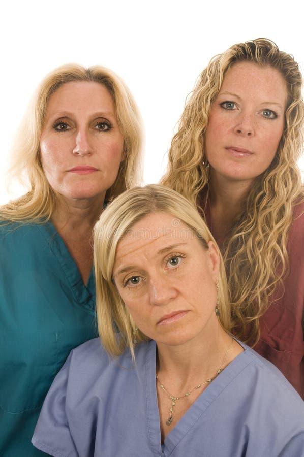 nutre a expressão séria das fêmeas médicas imagem de stock royalty free