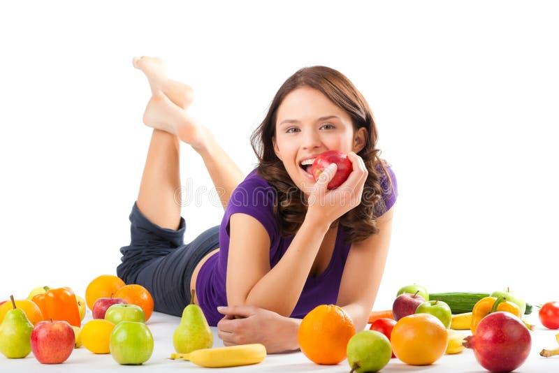 Nutrición sana - mujer joven con las frutas fotos de archivo
