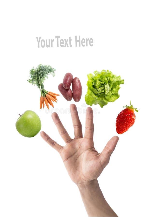 Nutrición y salud del concepto: coma la fruta y verdura cinco por día a su dieta, con una mezcla de fruta y verdura encendido imagenes de archivo
