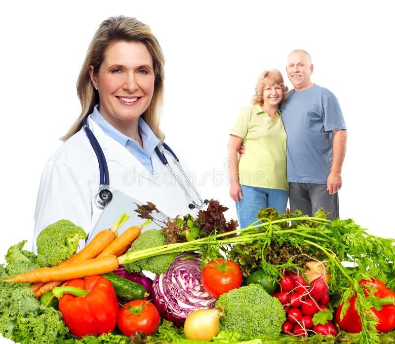 Nutricionista y familia del doctor fotos de archivo