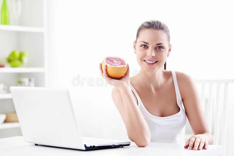 Nutrition. Attractive girl holding a grapefruit stock photo