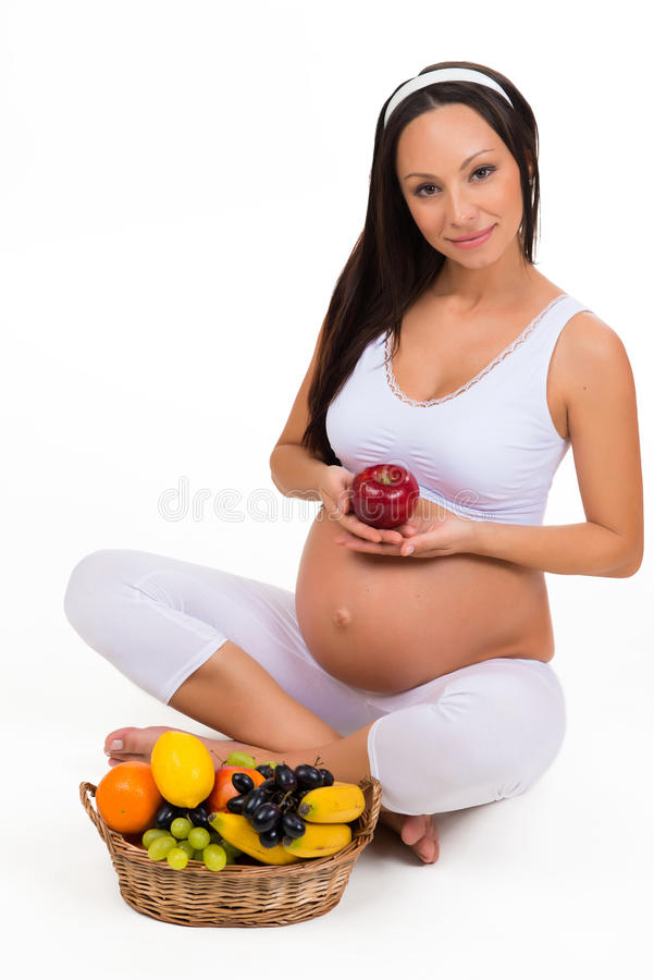 Nutrition appropriée pendant la grossesse Vitamines et fruit photographie stock libre de droits