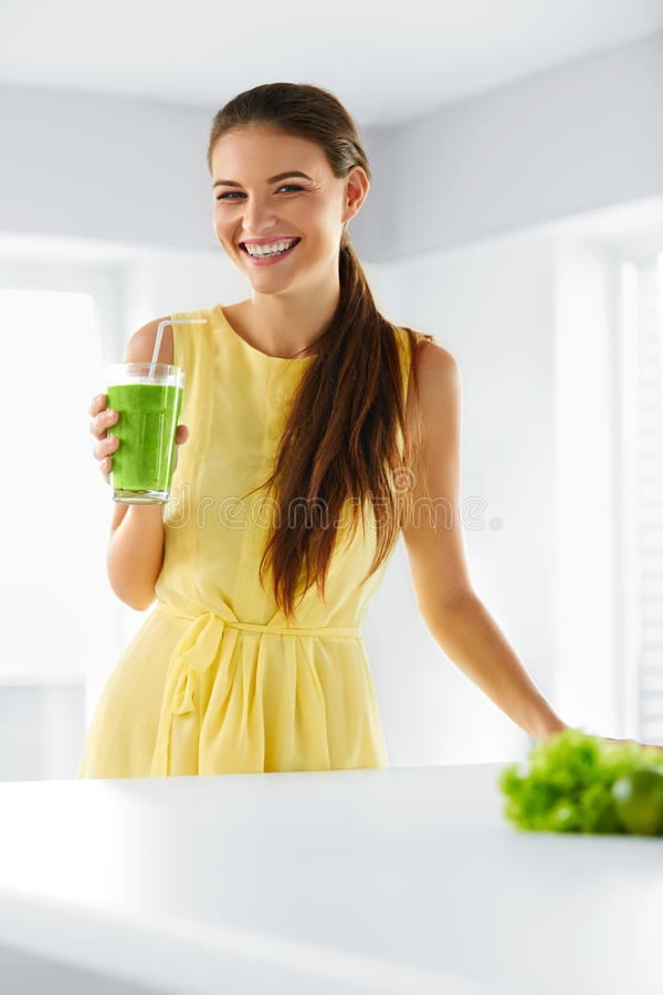 Nutrition. Healthy Eating Woman. Detox Juice. Lifestyle, Vegetarian Drink Diet. Nutrition. Healthy Eating Smiling Woman Holding Glass Of Fresh Raw Green Detox stock image