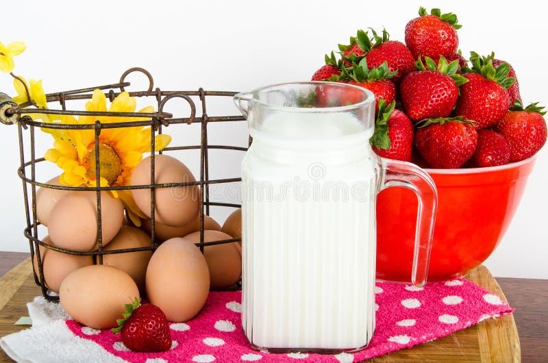 Nutritional breakfast of brown eggs, strawberries and milk stock image