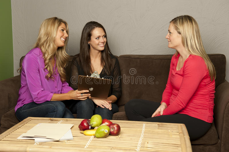 Nutritionist consult a pregnant female stock photos