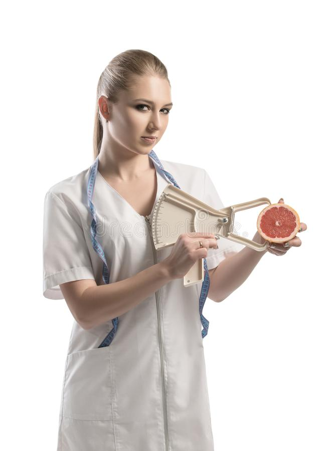 Nutritionist in white uniform with a tape-measure royalty free stock images