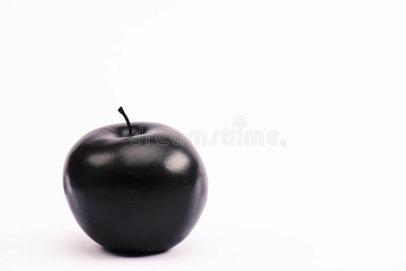 And nutritious apple on white with. Black and nutritious apple on white with copy space royalty free stock image
