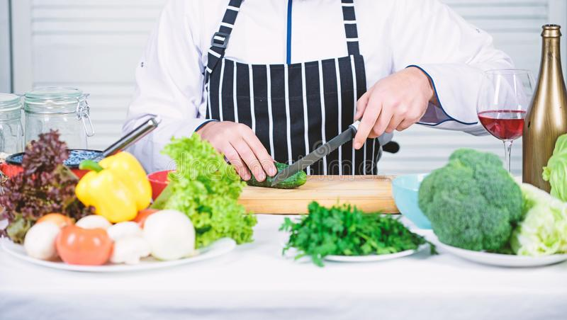 Nutritious breakfast. man cook in kitchen, culinary. Vegetarian. Dieting and organic food, vitamin. Chef man. Secret. Taste recipe. Healthy food cooking royalty free stock photography