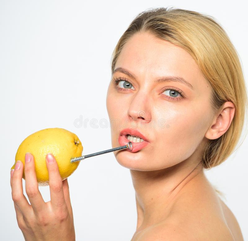 Nutritious drink fill with energy. Battery concept. Lemon with hobnail natural battery. Recharge your body vitamins royalty free stock image