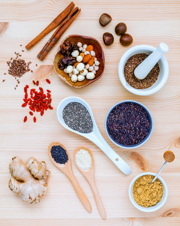 Nutritious Foods and Super foods selection with supplement powders in mortar and spoons setup on wooden background. Chia seeds stock photos