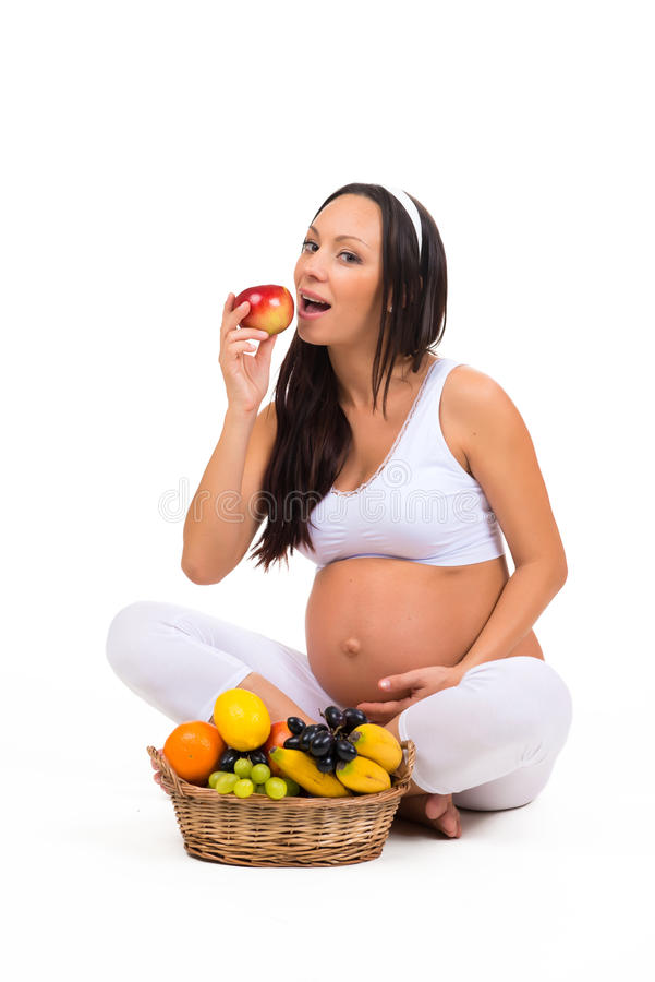 Nutrizione adeguata durante la gravidanza Vitamine e frutta fotografia stock
