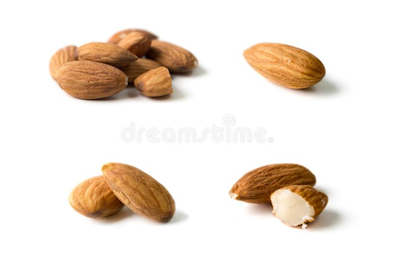 Nuts, almond, tasty and healthy food with lots of vitamins. Almond nuts. Almonds in groups and separated. Isolated on white background royalty free stock photography