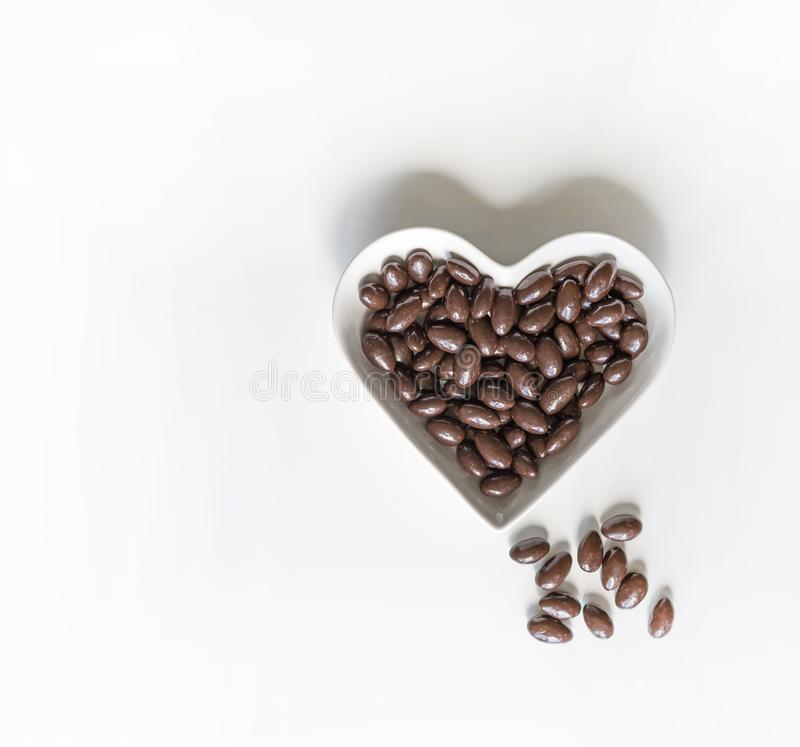Free Nuts Arranged In Heart Shape On Background. Food Image Close Up Candy, Chocolate Milk, Extra Dark Almond Nuts. Love Texture On Royalty Free Stock Images - 141592439
