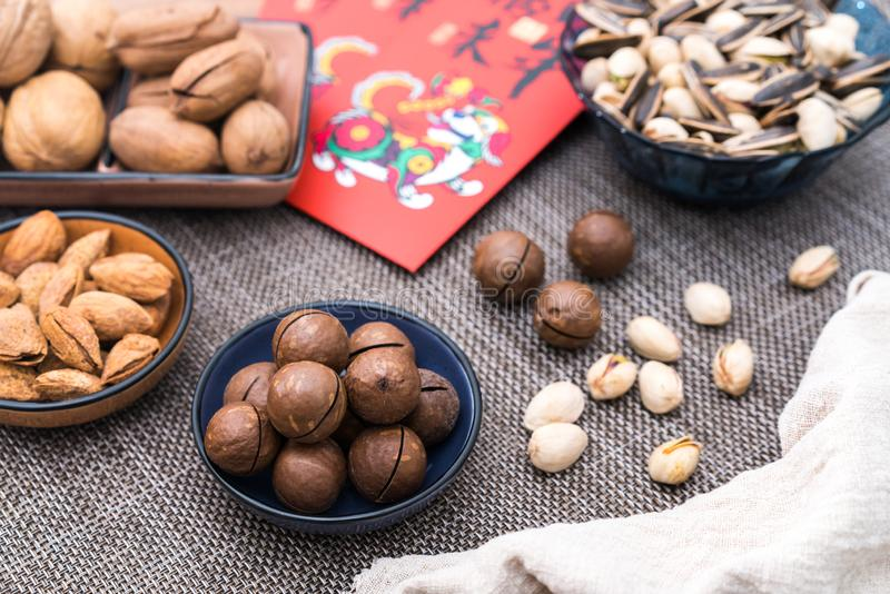 Nuts in the Background of Red Couplet in Spring Festival royalty free stock images