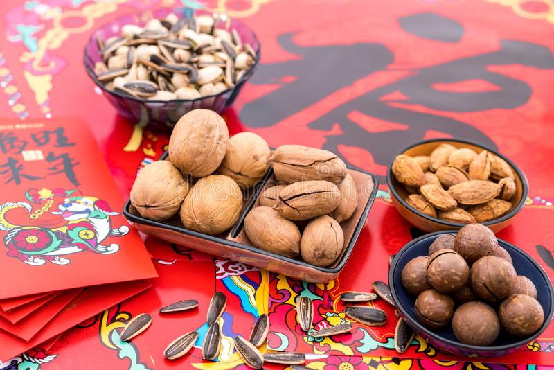Nuts in the Background of Red Couplet in Spring Festival royalty free stock photography