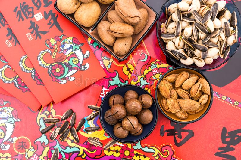 Nuts in the Background of Red Couplet in Spring Festival royalty free stock image