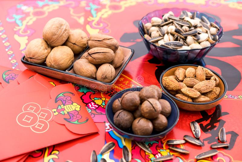 Nuts in the Background of Red Couplet in Spring Festival stock photos