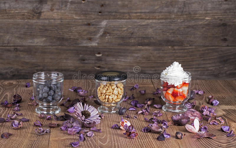 Nuts and berries in the glasses. With decoration stock photos