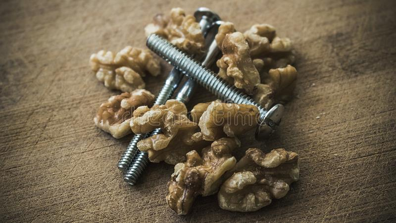 Nuts and bolts from above 2. A mix of walnuts and bolts as the common phrase, but with some humor and creative thinking. Excellent to illustrate: administration royalty free stock photo