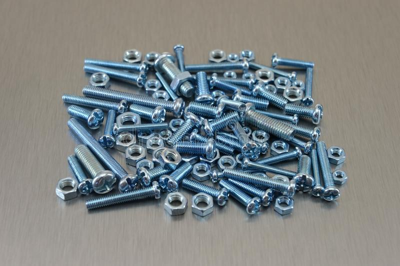 Nuts And Bolts. Against a white background royalty free stock images