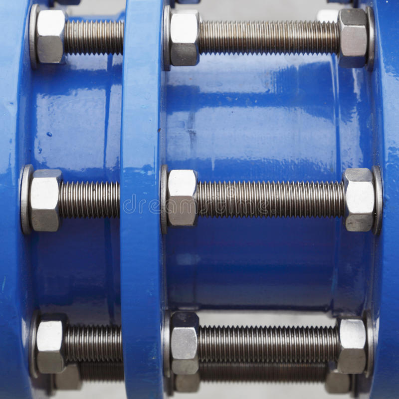 Nuts, bolts and washers. Through blue painted metal stock photography