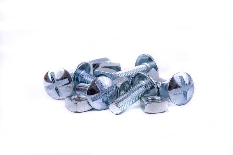 Nuts and Bolts on White. Stainless steel bolts showing different angles on an isolated white background royalty free stock image