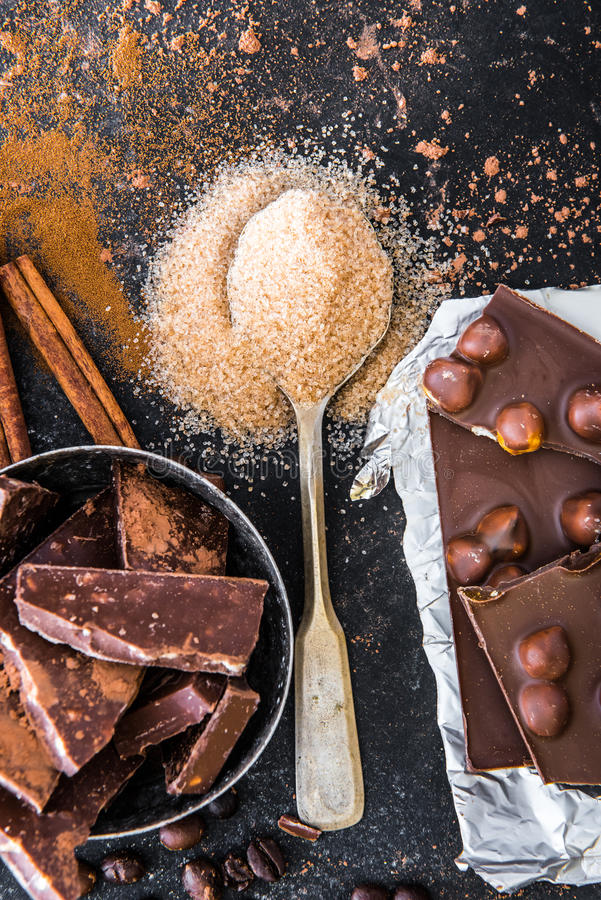 Nuts in chocolate and spices on a table stock photos