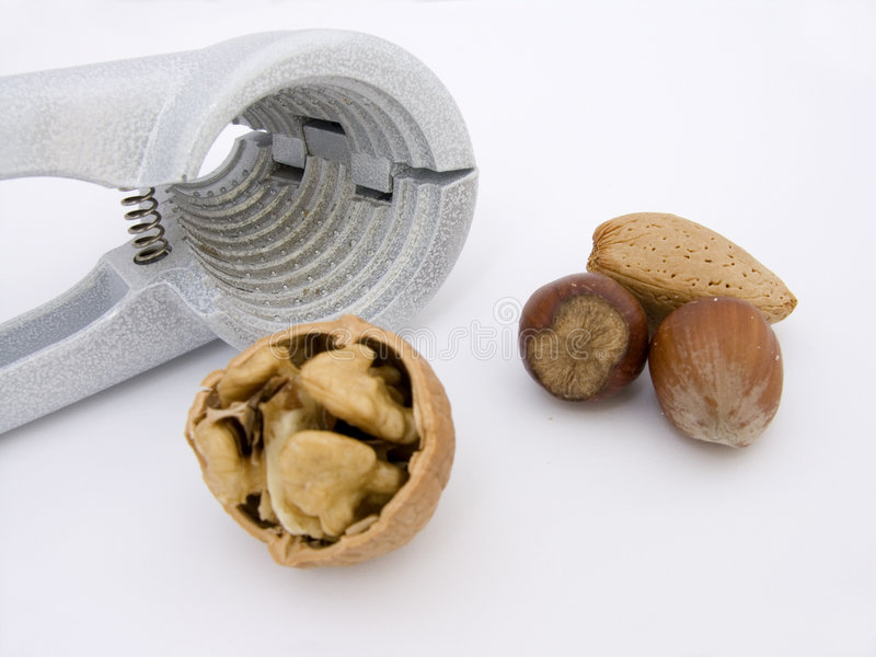 Nuts and cracker stock image