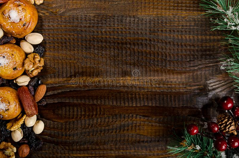 Nuts, dried fruits, pistachios and homemade cookies scattered from the bag on the table, New Year attributes, with a place for wri royalty free stock photo