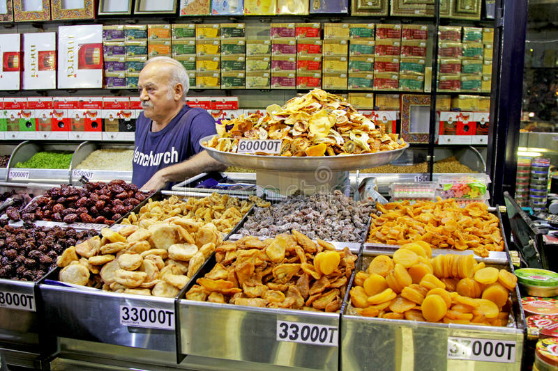 Nuts and dried fruits store in Tehran market. Nuts and dried fruits for sell in a store at local market in Tehran city. Those fruits are one of the most favorite stock illustration