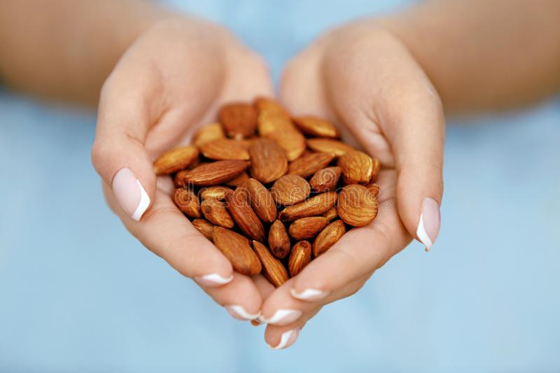 Nuts In Hands. Woman Hands Holding Healthy Food. Female Holding Healthy Snack. Nutrition And Diet Concept. High Quality Image royalty free stock images