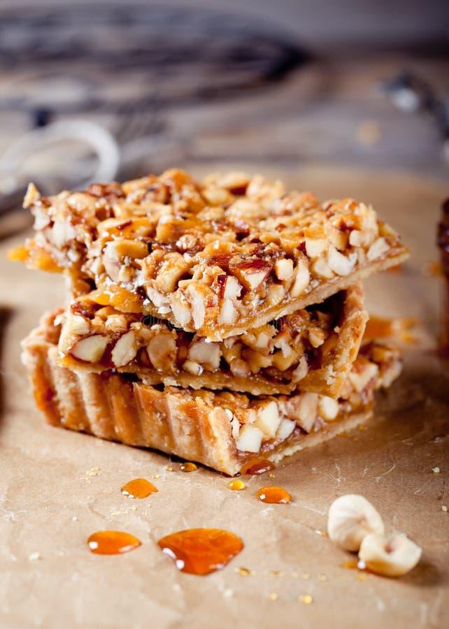 Nuts,maple syrup and honey caramel tart stock image