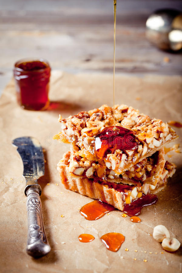 Nuts,maple syrup and honey caramel tart royalty free stock photo