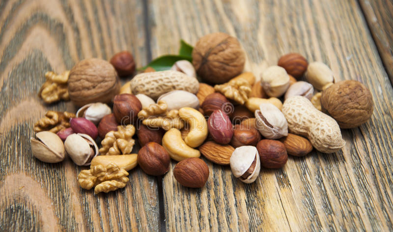 Nuts. Mixed nuts on a wooden background stock images