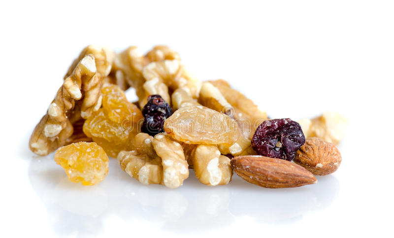 Nuts mixture with walnuts, raisins, cashew and dried fruits isolated on white royalty free stock image