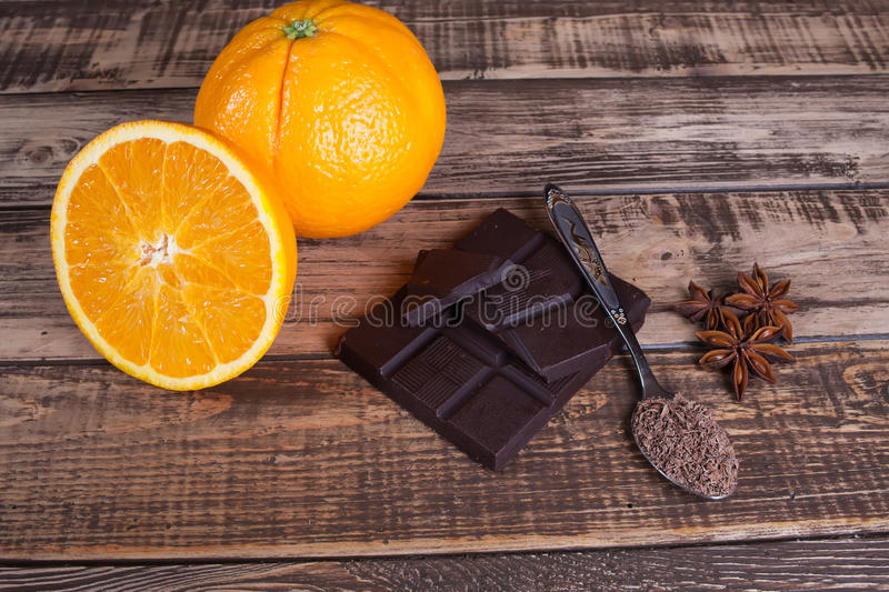 Nuts, orange, chocolate and different spices stock image