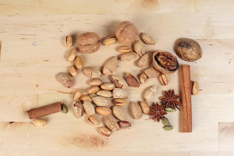 Nuts spice mix on rustic wood royalty free stock photos