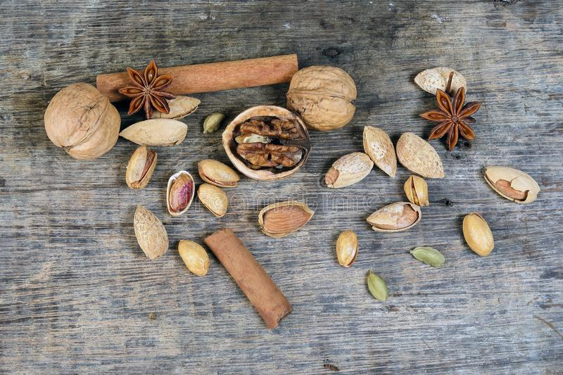 Nuts spice mix on rustic wood stock photography