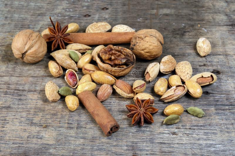 Nuts spice mix on rustic wood royalty free stock photography