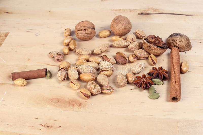 Nuts spice mix on rustic wood stock image
