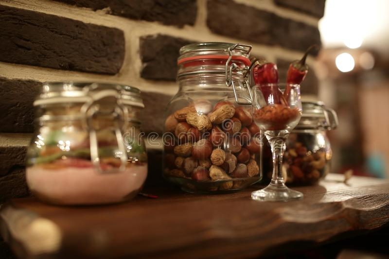 Nuts and spices in glass jar royalty free stock photography