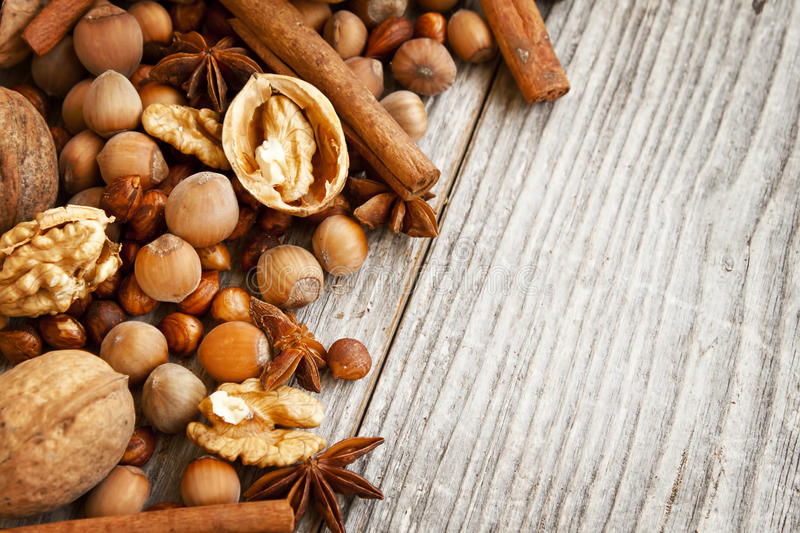 Nuts and Spices on Wooden Background